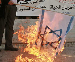 Jordanian protesters burning an Israeli flag at an anti-Israel protest in Amman last year