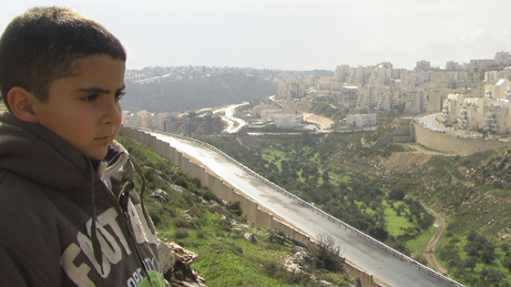 Emad's son Gibreel looks over at the Israeli settlements.A Kino