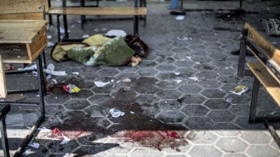 A trail of blood is seen in the courtyard of a UN school in the northern Beit Hanun district of the Gaza Strip on July 24, 2014, after it was hit by an Israeli tank shell