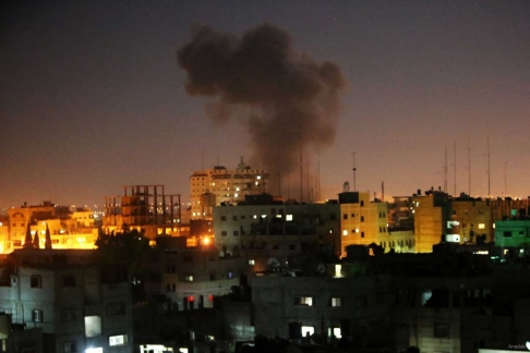 Smoke rises following an Israeli missile strike on Rafah, southern Gaza Strip on July 10, 2014 2
