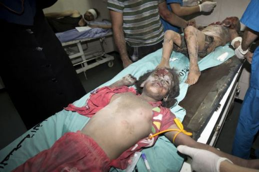 Wounded children are brought into the the al-Shifa hospital in Gaza City on July 9, 2014