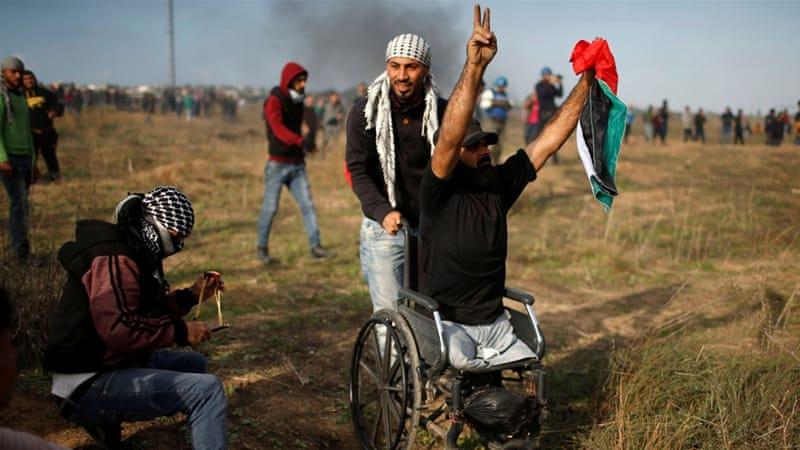 Znalezione obrazy dla zapytania palestyńczyk na wózku inwalidzkim